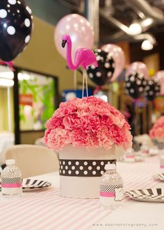 Flamingo Party via Hoopla Events. Choose this pink party theme for a girl's birthday. Styled with pink flamingos, it's a fun look that coordinates with a polka dot party theme too.