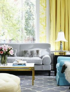 Grey couch, turquoise chair..this will be my living room! with white curtains and pops of navy