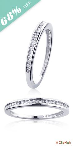 This beautiful 14K Gold Channel Diamond Womens Wedding Band showcases 0.31 carats of round channel set diamonds. Featuring a classy simple design and a highly polished gold finish, this ring is available in 14K white, yellow and rose gold.