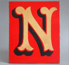 Hand-painted reclaimed wooden sign: fairground letter 'N'