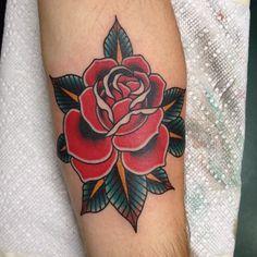 Rose tattoo by @brad_stevens on Instagram