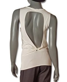 FROM CINDY GALLOP'S CLOSET Tom Ford for Gucci subtly sexy ivory silk knit tank which is all business (well, perhaps under a blazer) in front, all party in back. The front is a lowish V neck; the keyho
