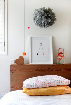love the simple art piece and geometric shapes.  would be cool  anywhere in the house or to have a few different framed shapes for a tasteful kid's space.