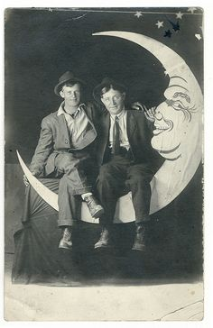 Two men on a paper moon by Vintage Photos & Collectables, via Flickr