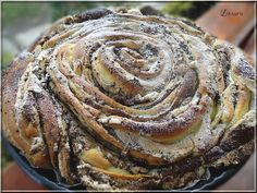 Limara péksége: Habcsókos rózsa = LIMA Bakery: Habcsókos rose. I THINK it is like a huge cinnamonbun, or with other filling than cinnamon. Feel free to correct me. I THINK it's a Hungarian bun!