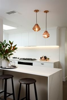 Reno Rumble by Freedom Kitchens White modern kitchen with Carrara stone / marble benches and cooper pendant lights Metal Kitchen Cabinets, Stone Kitchen, Kitchen Wall Tiles, New Kitchen, Wall Cabinets, Kitchen Interior, Kitchen Decor, Kitchen Ideas, Kitchen Centerpiece