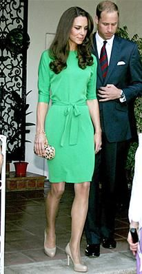 The Duchess of Cambridge stopped by a reception at the British Consul-General's residence wearing a belted emerald green dress and a leopard-print clutch, both by Diane von Furstenberg.