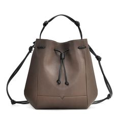 The Bucket Backpack in Taupe and Black from von Holzhausen featuring natural grained soft Italian leather with painted edges.  Wear it as a backpack, shoulder bag, or handheld style. Made in the USA.