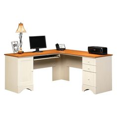 Sauder Harbor View Corner Computer Desk - Antiqued White - Made of engineered wood in antiqued white Melamine top surface with slide-out keyboard/mouse shelf 3 drawers, grommet hole for cord management...