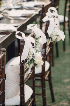Elegant chair decor for wedding reception. #weddingreception #chairdecor #weddingchicks Designed By: Joie de Vivre & Co ---> http://www.weddingchicks.com/2014/04/24/timeless-california-wedding/
