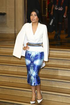 Dressed in a beautiful white top and a blue patterned pencil skirt, the 27-year-old Princess attended the Balmain show.