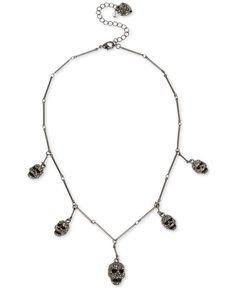 """Be the mistress of the night in this sensational sparkling pave skull station statement necklace fashioned by Betsey Johnson in hematite-tone mixed metal. Approximate length: 16"""" + 3"""" extender. Approx"""