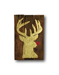 **All orders placed by 12/3/16 will be shipped in time for delivery by 12/24/16.**    Vintage / Rustic look Christmas decor. Hand painted on reclaimed wood. Reindeer silhouette in gold glitter with Rudolphs red nose in red glitter! This sign is approximately 9x16 in size. This sign can be hung on the wall or to decorate your front door. Looks great on the mantle or beside the fireplace as well. As each sign is custom made to order, slight variations in wood size and coloring may occur.