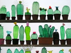 Veronika Richterova uses PET bottles for these beautiful creations. Using just scissors, a hair dryer and colors she transforms regular plastic bottles into art.