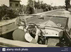 Vintage Car Woman Driving High Resolution Stock Photography and Images - Alamy 1920s Photos, Vintage Photographs, Morgan Roadster, Napier New Zealand, Chrysler Convertible, Vintage Filters, Jaguar Xk120, Pink Cadillac, Vintage Vans