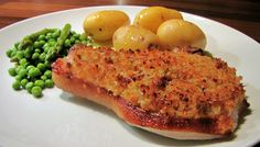 Tender pork chop with a crust made from freshbreadcrumbs, cheese, lemon zest, thyme & tarragon. Serve with buttered new potatoes and a crisp salad or vegetables.