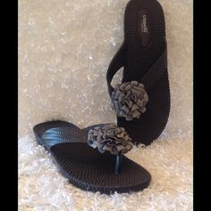 """Capelli New York Black Thong Sandals Capelli New York Black Thong Flip Flops. Black with a silver fabric rose across strap. Low 1"""" wedge heel. Gently used. Smoke free home. Capelli New York Shoes Sandals"""