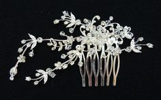 Vintage Style Flower and Leaves Spray Crystal Bridal by lecocopink    I think I'm going with this one.
