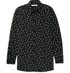 Cut in Givenchy's long and loose 'Columbian' fit, this silk shirt is designed to drape over the body with ease. It has been made in France by expert hands and is finished with a structured classic collar for a sharp finish. The subtle floral print is offset by a strong black background, in keeping with the brand's dark romanticism. Team yours with slim distressed denim and sneakers.