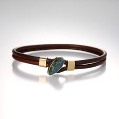 This casual Jamie Joseph bracelet is full of eye-catching color. The asymmetrical Boulder opal is the focal point on a doubled, light brown leather cord, and 14k yellow gold accents add a touch of refinement to an otherwise laid-back look. Mix this bracelet into your favorite stack to make a more personalized statement! @QUADRUM