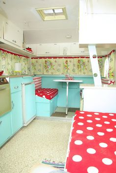 I like the red accent at the top of the curtains on this adorable little camper. Good use of color blocking.