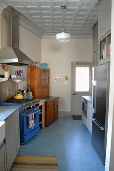 WREN handmade remodel. The floor is Marmoleum in spa from Green Depot. The stove and hood are from Bluestar.