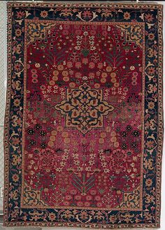 Vase Carpet    Object Name:      Carpet  Date:      17th century  Geography:      Iran, probably Kirman  Medium:      Cotton (warp), silk (weft), wool (weft and pile); asymmetrically knotted pile  Dimensions:      Rug: H. 81 1/2 in. (207 cm) W. 56 in. (142.2 cm)  Classification:      Textiles