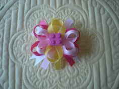 Hey, I found this really awesome Etsy listing at http://www.etsy.com/listing/130253895/pink-yellow-custom-made-lego-bows