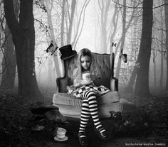 Alice sits all by herself in the dark forest.