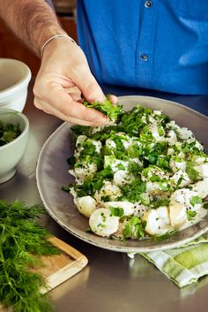 Creamy, tangy mayonnaise dressing stirred into pillowy chunks of potatoes and sprinkled with table salt and black pepper. Yes, please!