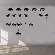 Space Invaders Wall Sticker East Urban Home Size: Extra Large, Colour: Beige Dinosaur Wall Stickers, Letter Wall Stickers, Childrens Wall Stickers, 3d Butterfly Wall Stickers, Wall Stickers Murals, Space Invaders, Its A Girl Balloons, Colour Yellow, Colour Light