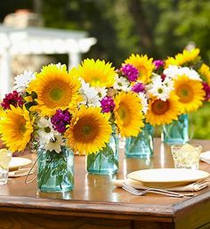 Vibrant sunflower centerpieces perfect for a sunflower themed wedding.