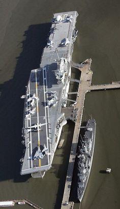 The World War II-era aircraft carrier Yorktown sits beside the destroyer Laffey…