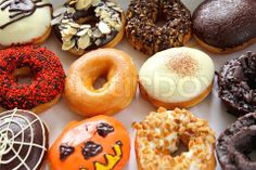 Image of 'Varieties of decorated donuts' on Colourbox