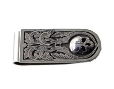 Silver engraved skull money clip by Richard Stump for Tom Taylor.