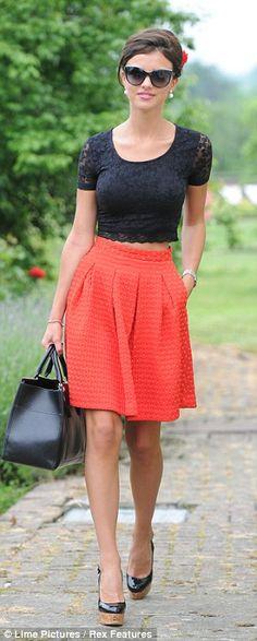 Lucy Mecklenburgh - black cropped top & orange skater skirt