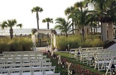 The Lawn at The Members Beach Club - The Ritz Carlton, Sarasota, FL - The beachfront, event lawn, located directly behind The Members Beach Club and steps from the sand, offers an elevated open-air pergola, lushly landscaped  surroundings and spectacular views of the Gulf of Mexico. Accommodates parties up to 200.