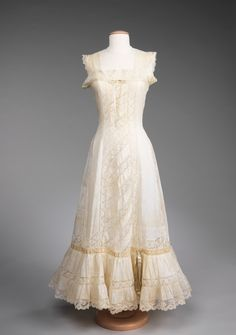 Slip, 1910-15, French. An example of a form of underpinning that combined the petticoat and corset cover into one piece, this example of Belle Époque underwear shows the typical lavishly sewn details common during this period, even for so-called unmentionables. The Belle Époque period, which lasted from the late nineteenth century to World War I, saw great detail in garment decoration, and as this slip exhibits, in the undergarments as well.