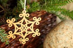 Laser engraved wood snowflake ornament by Urban Timber Woodworks