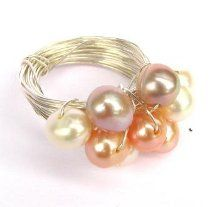 This chunky Wire and Pearl Ring combines delicate freshwater pearl colors with edgy wire-wrapping to create a sophisticated and stunning look.