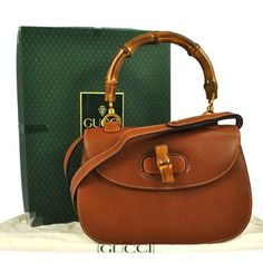 Gucci Logos Bamboo Handle Hand Leather Vintage Italy Box Brown Tote Bag. Get one of the hottest styles of the season! The Gucci Logos Bamboo Handle Hand Leather Vintage Italy Box Brown Tote Bag is a top 10 member favorite on Tradesy. Save on yours before they're sold out!