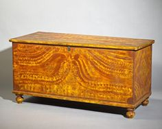 """York County Blanket Chest Dimensions: H 24"""", W 48"""", D 20 1/2""""   Date / Circa: Circa 1830-50   Maker / Origin: Unidentified   Medium: Pine with the original free-hand and sgraffito paint-decorated finish.   Miscellaneous: Illustrated: Fabian, The Pennsylvania-German Decorated Chest, fig. 248."""