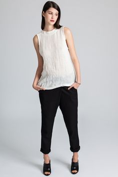 Mayne pant by eco-focused Canadian fashion label Pillar. Loose fitting pant with fold over front and elasticated waist. Legs taper at ankle. Ethically made in Vancouver, Canada. Elastic Waist Pants, Fashion Labels, Slow Fashion, Cropped Pants, Black Pants, Fashion Forward, Normcore, Legs, Chic