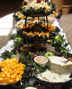 This is nice - get height from tiered basket .... Soft cheese (like blue or brie) can be left in wedge