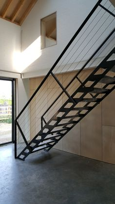 Lazer cut steel stair, powder coated black and cable balustrade www.rawarchitecture.net
