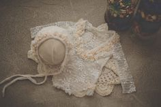 hand beaded with fresh water pearls on a beautiful see through lace pattern. This set includes a bonnet and romper size newborn
