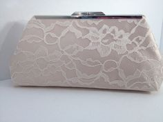 A personal favorite from my Etsy shop https://www.etsy.com/listing/187747714/ivory-lace-over-champagne-satin-clutch