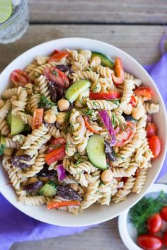 This Creamy Tahini Greek Pasta Salad is so easy to make and perfect for lunch!  It's vegan, gluten free and full of delicious vegetables and creamy pasta!