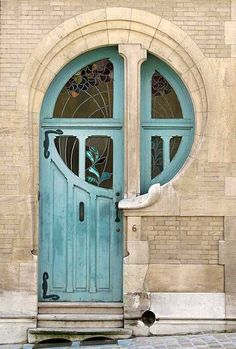 Unique front door inspiration for using my initial in the design. Love the curved wood frame in the door and around as well as the stained glass!