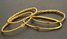 Viking bracelts of gold found in Sweden. These armrings were worn by men and the sagas tell that they where exchanged as gifts as a proof of loyalty. Dated: 800-1050 after Christ.